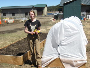 Chinook West student completes a hoop house in the TEENS, Inc garden