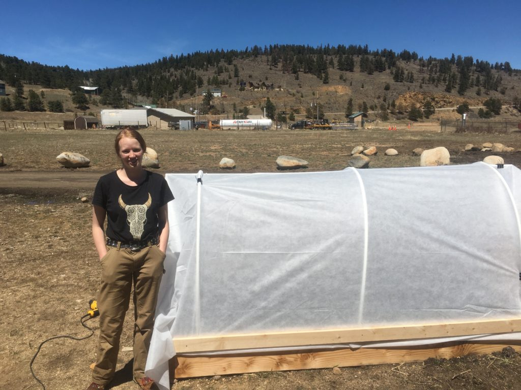 Chinook West Student and completed hoop house